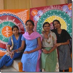 Young girls with their Rangoli inspired artwork.