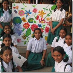 Indian schoolgirls with their floral artwork.