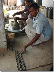 Minori's two sons making Tali for Davali