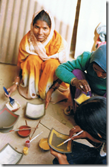 The first workshop, women painting square plates, 2002