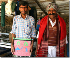 Tejsi Dhana Marwada (R) master Kharad weaver with his cousin Sumar, holding a weaving made from plastic bags.