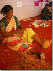 Woman weaving twine from grass, Orissa