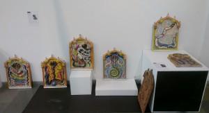 Jumna Lal Kumhar ceramic plaques progressing from Naga Hindu snake god to Rainbow Serpent