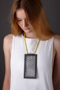 Katheryn Leopoldseder - Security Amulet, screen door pendant (oxidised copper, stirling silver, yellow Howelite beads, silk, 2013)