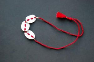 Sandra Bowkett necklace, porcelain and cotton, 2012