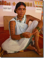 Tribal woman making figurines from rice grains, Orissa