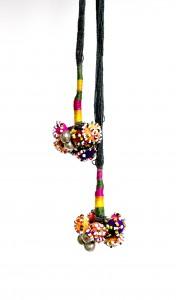 Sitaben. Hair tie. buttons, bells, beads, thread. 2010